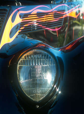 engine compartment: Car - roadster - tight view of front headlight and side of engine compartment - flame paint highlights