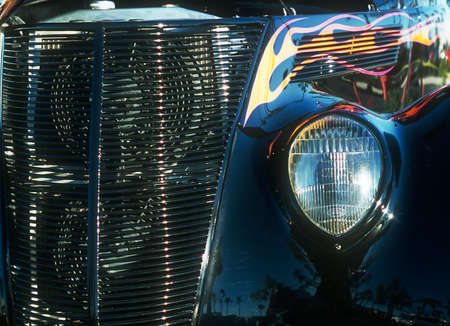 grille: Car - roadster - view of front headlight and front grille - flame paint hightlights