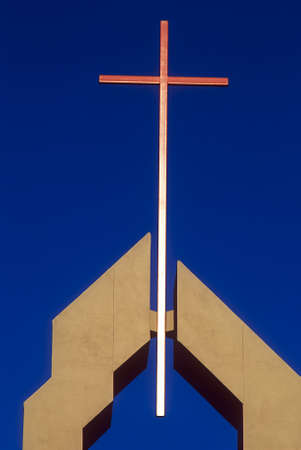 an erection: Church - Copper cross in top of modern steeple Stock Photo