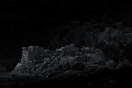 Dramatic B&W photo of a fallen Anasazi tower in the moonlight.
