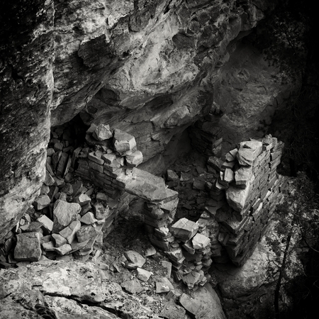 Looking down into the remains of an Ancesteral Puebloan ruin. Part of an ancient pueblo in Canyons of the Ancients National Monument. A  black and white photograph of the Anasazi culture recorded in the style of the turn of the century explorers who first