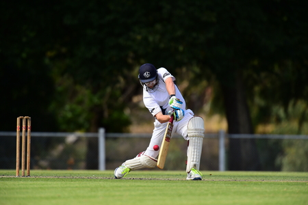 A batsman clips the ball during a cricket match in Victoria Australia