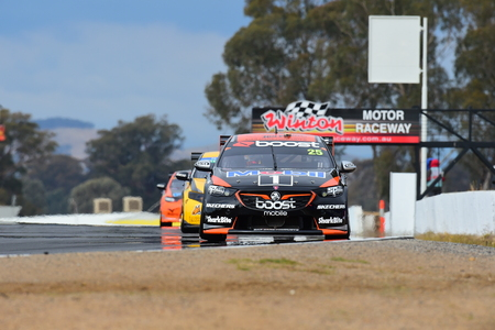 Virgin Australia Supercars Championship 2018 Round 14 Winton Supersprint. James Courtney of Mobil 1 Boost Mobile Racing in his Holden Commodore ZB leads the chasing pack going toward 4 at Winton Motor Raceway. Editorial