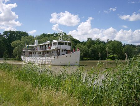 concerning: Concerning passenger steamer on Swedish canal in summer light Stock Photo