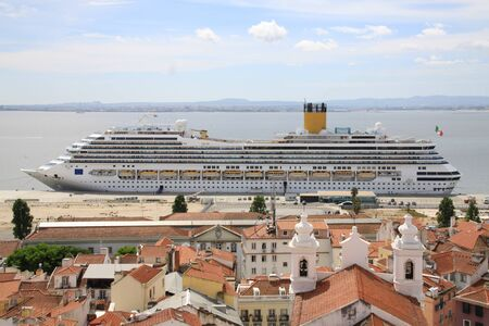 cruiseliner: Cruise liner in front of the old town of Lisbon