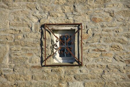 metal grid: Small window with metal grid Stock Photo