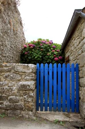 garden gate: Blue garden gate with stone wall in Brittany
