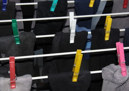 clothesline: Closeup of socks with colorful clothes pegs on the clothesline