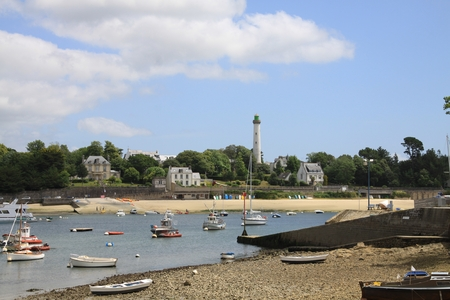 brittany: Small harbor with lighthouse in Brittany Stock Photo