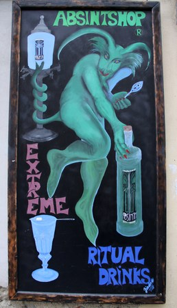 ajenjo: old advertising poster for absinthe in the historic center of Prague