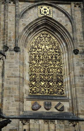 gothic window: old gothic window with golden wrought iron ornament