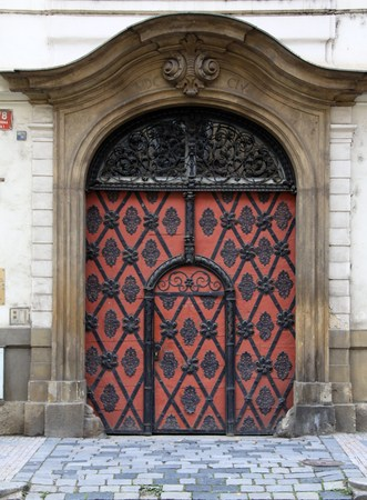 fittings: Big red old door with wrought-iron fittings