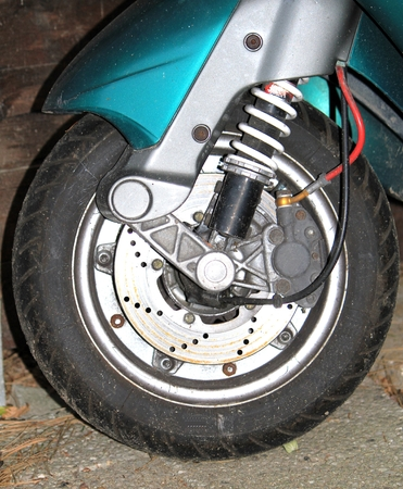 hubcap: Front whell of a motorscooter