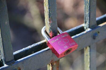 oath: Padlock on bridge railing as love oath