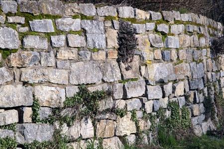 weathered: weathered stone wall of rubble Stock Photo