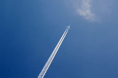 airliner: Airliner on blue sky with contrails