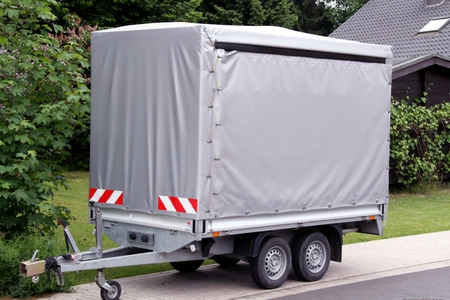 car trailer with high gray tarp