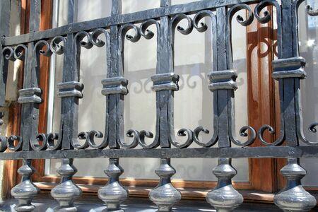 window bars: old wrought iron ornate window bars