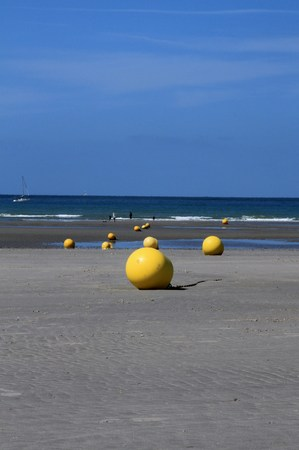 Yellow buoys at low tide in northern France