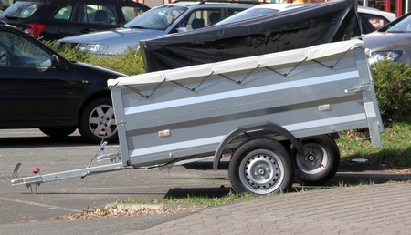 Small car trailer with aluminum construction and tarpaulin
