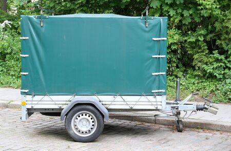 tarpaulin: Car trailer with green tarpaulin Stock Photo