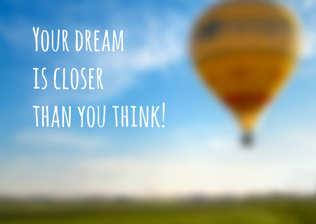 Vector blurred background with a balloon and an inspiring motto, eps10.