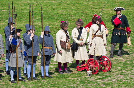 KOLOMNA, RUSSIA - JUNE 12, 2015: Members of history clubs represent Russian soldiers from the times of Peter I (1672-1725) on June 12, 2015 in Kolomna, Russia. Reenactors wear the uniform of pikemen and bombardiers.