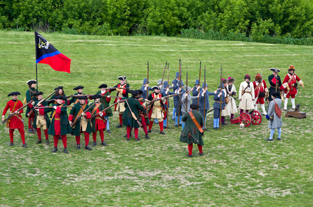 KOLOMNA, RUSSIA - JUNE 12, 2015: Members of history clubs represent Russian musketeers, pikemen, bombardiers and grenadiers from the times of Peter I (1672-1725) on June 12, 2015 in Kolomna, Russia. Reenactors demonstrate elements of military drill. Editorial