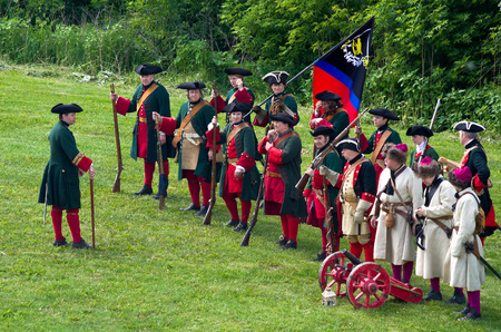KOLOMNA, RUSSIA - JUNE 12, 2015: Members of history clubs represent Russian soldiers from the times of Peter I (1672-1725) on June 12, 2015 in Kolomna, Russian Federation. Reenactors wear the uniform of musketeers and bombardiers.
