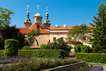 church flower: St. Lawrence Church and gardens near it. Petrin hill, Prague, Czech Republic.