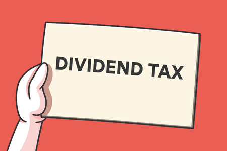Hand holding a piece of paper with the words dividend tax