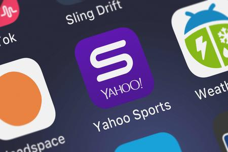 London, United Kingdom - September 29, 2018: Close-up of the Yahoo Sports: Scores  News icon from Yahoo on an iPhone. Editorial