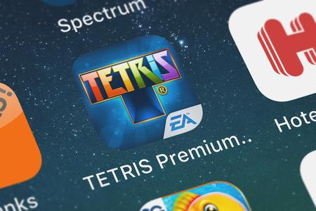 London, United Kingdom - September 29, 2018: The TETRIS® Premium for iPad mobile app from Electronic Arts on an iPhone screen. Editorial