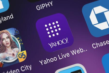 London, United Kingdom - September 29, 2018: Close-up shot of the Yahoo Live Web Insights application icon from Yahoo on an iPhone.