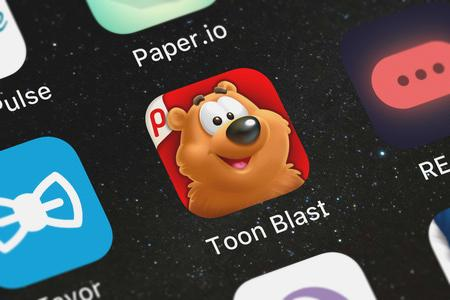 London, United Kingdom - September 30, 2018: Screenshot of the Toon Blast mobile app from Peak Games icon on an iPhone.
