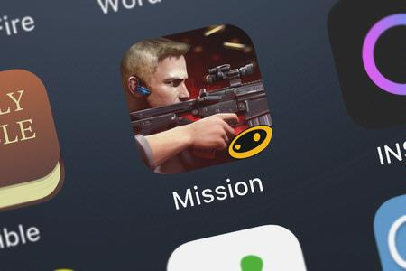 London, United Kingdom - October 03, 2018: Close-up shot of the Mission: Impossible - Rogue Nation application icon from Glu Games Inc on an iPhone.