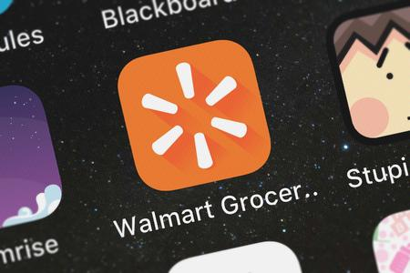 London, United Kingdom - October 03, 2018: Icon of the mobile app Walmart Grocery from Walmart on an iPhone.