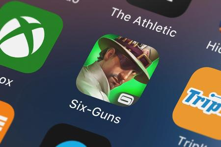 London, United Kingdom - October 03, 2018: The Six-Guns mobile app from Gameloft on an iPhone screen.