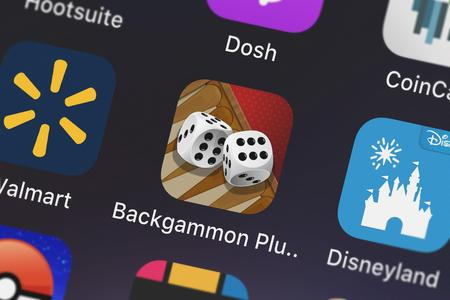 London, United Kingdom - October 03, 2018: Close-up of the Backgammon Plus HD icon from Zynga Inc. on an iPhone.