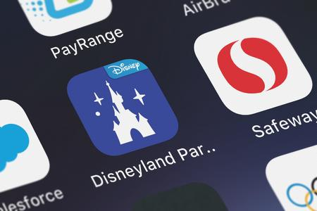 London, United Kingdom - October 03, 2018: The Disneyland® Paris mobile app from Disney on an iPhone screen. Editorial