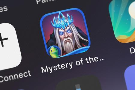 London, United Kingdom - October 05, 2018: Close-up shot of the Mystery of the Ancients: Deadly Cold HD - A Hidden Object Adventure (Full) application icon from Big Fish Games, Inc on an iPhone. Archivio Fotografico - 117652479