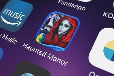 London, United Kingdom - October 05, 2018: Close-up of the Haunted Manor: Painted Beauties HD - A Hidden Objects Mystery (Full) icon from Big Fish Games, Inc on an iPhone.