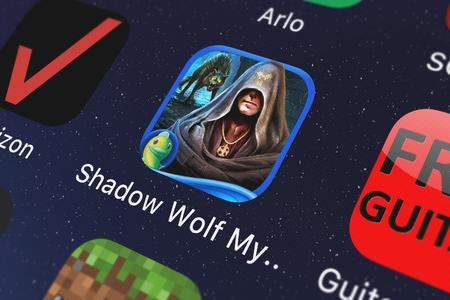 London, United Kingdom - October 05, 2018: Icon of the mobile app Shadow Wolf Mysteries: Curse of Wolfhill (Full) from Big Fish Games, Inc on an iPhone.