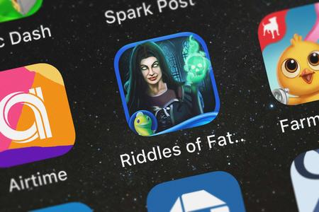 London, United Kingdom - October 05, 2018: Screenshot of the Riddles of Fate: Into Oblivion - A Hidden Object Puzzle Adventure mobile app from Big Fish Games, Inc icon on an iPhone.