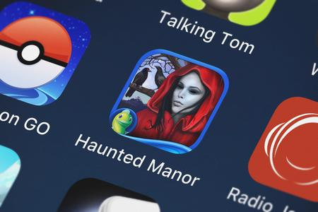 London, United Kingdom - October 05, 2018: Close-up of the Haunted Manor: Painted Beauties HD - A Hidden Objects Mystery icon from Big Fish Games, Inc on an iPhone.