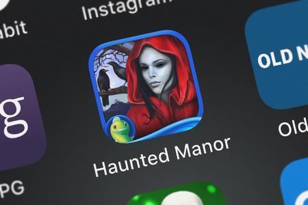 London, United Kingdom - October 05, 2018: Close-up shot of the Haunted Manor: Painted Beauties - A Hidden Objects Mystery application icon from Big Fish Games, Inc on an iPhone.