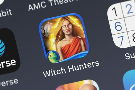 London, United Kingdom - October 05, 2018: Close-up of the Witch Hunters: Full Moon Ceremony HD - A Mystery Hidden Object Story icon from Big Fish Games, Inc on an iPhone.