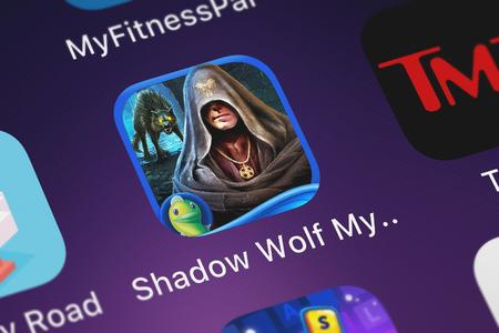 London, United Kingdom - October 05, 2018: Screenshot of the Shadow Wolf Mysteries: Curse of Wolfhill mobile app from Big Fish Games, Inc icon on an iPhone. Editorial