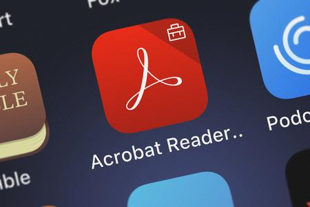 London, United Kingdom - October 05, 2018: Close-up of the Adobe Acrobat Reader Intune icon from Adobe on an iPhone. 写真素材 - 119170162