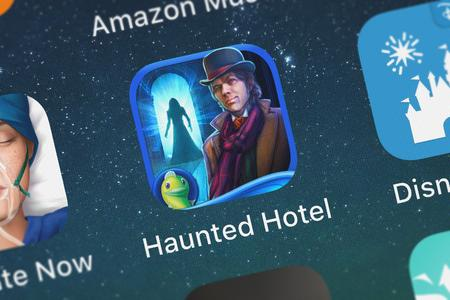 London, United Kingdom - October 05, 2018: Close-up shot of Big Fish Games, Incs popular app Haunted Hotel: Ancient Bane HD - A Ghostly Hidden Object Game.